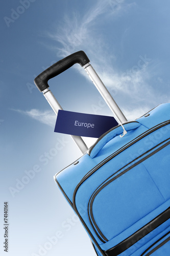 canvas print picture Europe. Blue suitcase with label