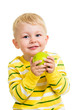 little boy eating green apple