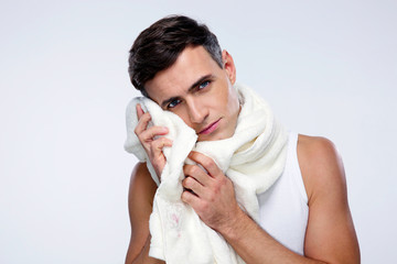 Portrait of a man drying his face with towel