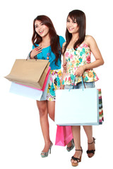happy shopping two girl holding bags