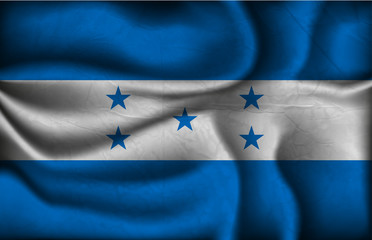crumpled flag of Honduras on a light background
