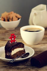 Carrot cake with coffee and teddy bear stick