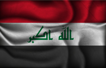 crumpled flag of Iraq on a light background
