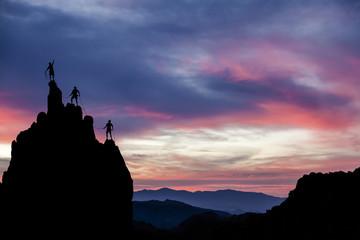 Climbing team on the edge.