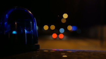 close-up of flashing light on a police car