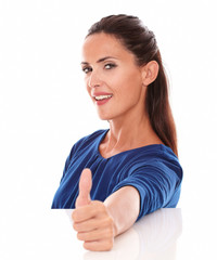 Pretty latin woman in blue t-shirt with thumb up