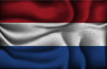 crumpled flag of Netherlands on a light background