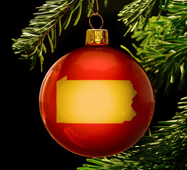 Red bauble with the golden shape of Pennsylvania