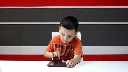 Child using a tablet  slide finger