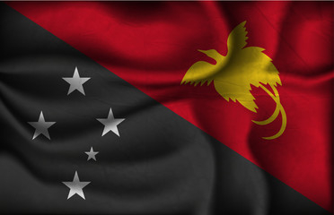 crumpled flag of Papua New Guinea on a light background
