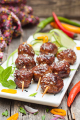 Japanese skewers of pork with soy sauce and sesame seeds