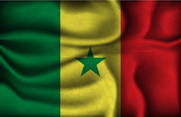 crumpled flag of Senegal on a light background