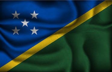 crumpled flag of Solomon Islands on a light background