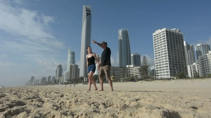 Couple visit on Main Beach in Surfers Paradise
