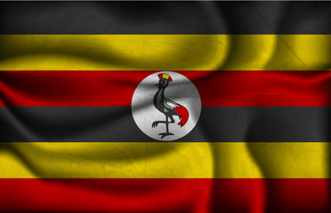crumpled flag of Uganda on a light background
