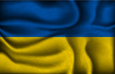 crumpled flag of Ukraine on a light background