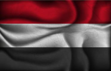 crumpled flag of Yemen  on a light background