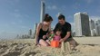 Family builds sand castle 02