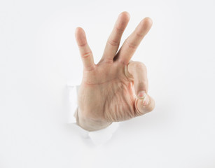 Hand punching through paper