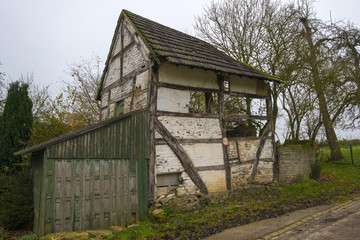 Timbered house on a mound at fall