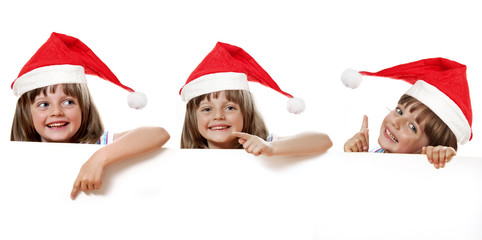 little girl with santa cap holding  white board