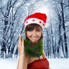 Pretty woman in santa cap, winter nature