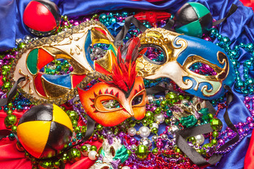 Three Mardi Gras Masks and Beads