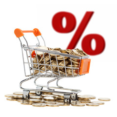 Gold coins in shopping cart with sign of sale on background