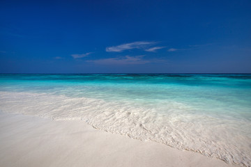 beach with clear waters and white fine sand