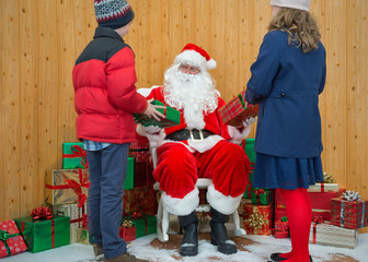 Boy and Girl receiving gifts from Santa