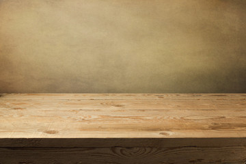 Wooden table over grunge wallpaper