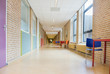 Leinwanddruck Bild - Long corridor with furniture in school building