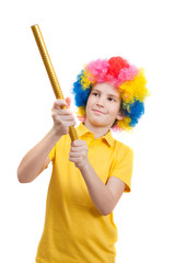Smile boy in clown wig with party poppers