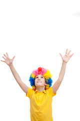 Funny boy in clown wig against white background