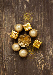 Golden Vintage Balls and Gifts with Glitter on Wooden Background