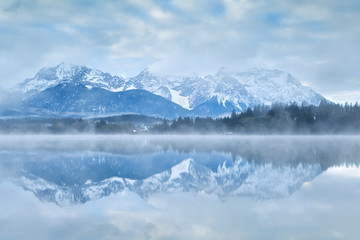 Karwendel mountain range reflected in lake