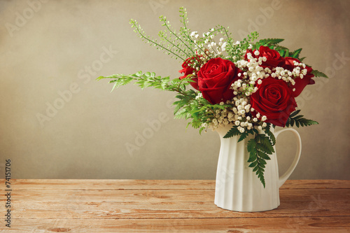 canvas print picture Rose flower bouquet on wooden table with copy space