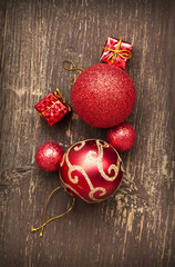 Red Vintage Christmas Balls and Gifts on Wooden Background