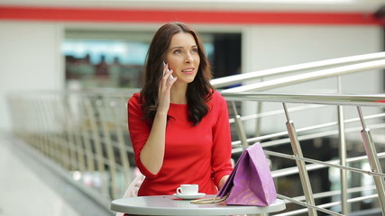 The young woman phones  in the business center