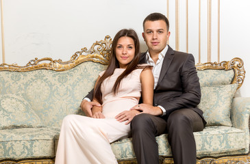couple in love hugging on luxurious sofa