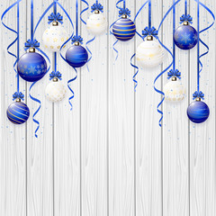 Blue Christmas balls on wooden background