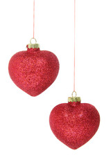 red glitter christmas baubles isolated on white background