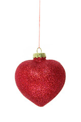 red glitter christmas bauble isolated on white background