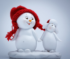 Cheerful snowman and penguin