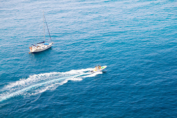 A Boat and a Yacht in the Mediterranean sea, Italy