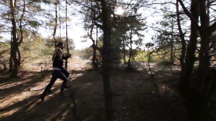 Couple running among wood