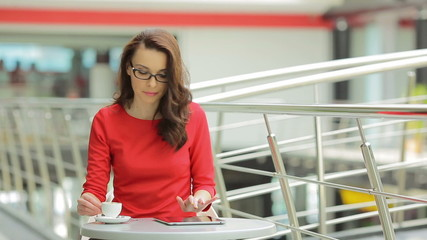 The young woman drink coffee in the business center