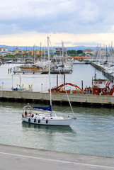 Yacht sailing in the port of Rimini