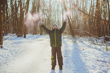Portrait of a boy playing outdoors in the snow