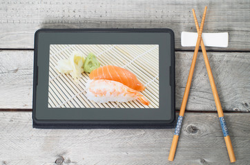 On-line and web asian food ordering concept with digital tablet
